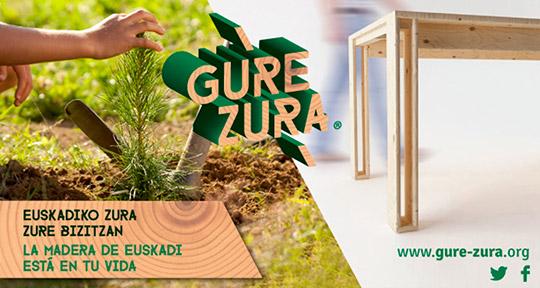 Imagen de la campaña de GURE ZURA con una foto de la mesa ARINA de Muebles LUFE